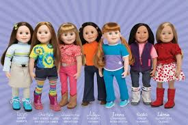 7 Maplelea Girl dolls standing in a row